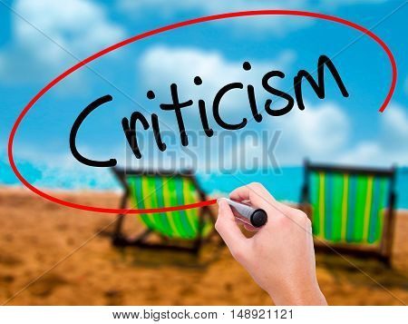 Man Hand Writing Criticism With Black Marker On Visual Screen