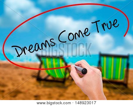 Man Hand Writing Dreams Come True With Black Marker On Visual Screen
