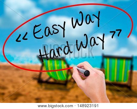 Man Hand Writing Easy Way - Hard Way With Black Marker On Visual Screen.