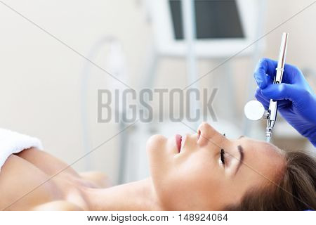 Picture of woman having facial treatment in beauty salon