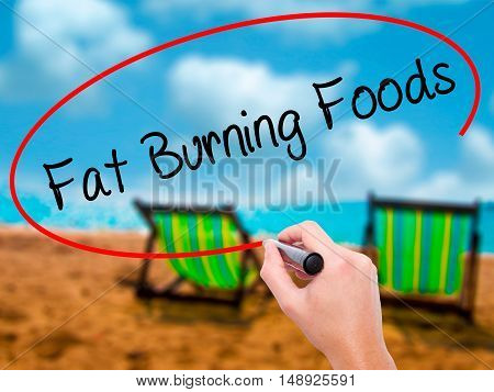 Man Hand Writing Fat Burning Foods With Black Marker On Visual Screen