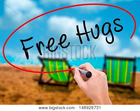 Man Hand Writing Free Hugs With Black Marker On Visual Screen
