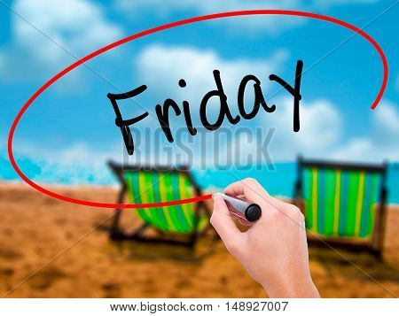 Man Hand Writing Friday With Black Marker On Visual Screen