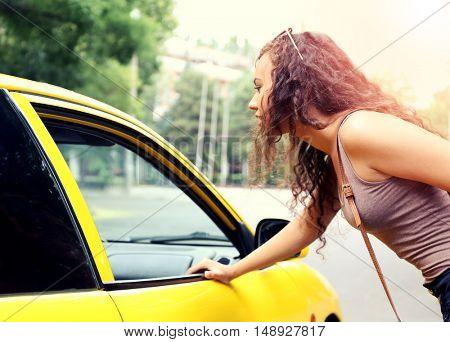 Taxi passenger near car