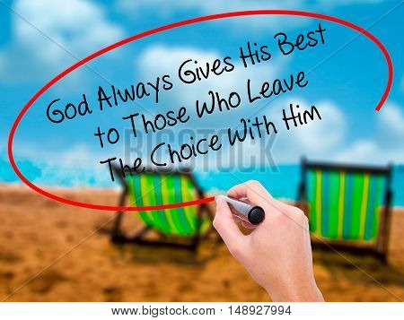 Man Hand Writing God Always Gives His Best To Those Who Leave The Choice With Him With Black Marker