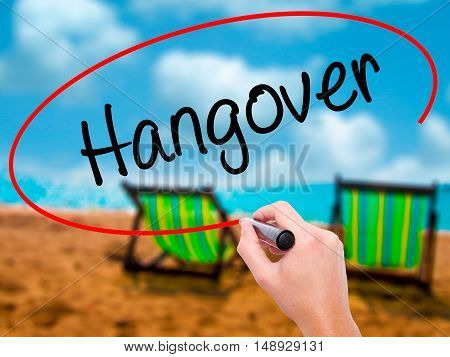 Man Hand Writing Hangover With Black Marker On Visual Screen