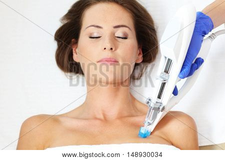 Picture of woman having breast mesotherapy in beauty salon