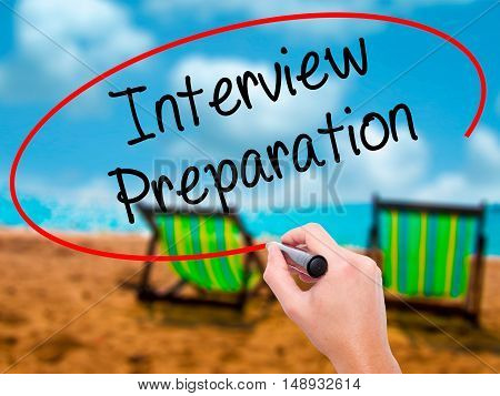 Man Hand Writing Interview Preparation With Black Marker On Visual Screen