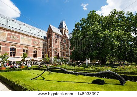 Amsterdam Netherlands - July 03 2016: Some people visit to garden of Rijksmuseum sunny day