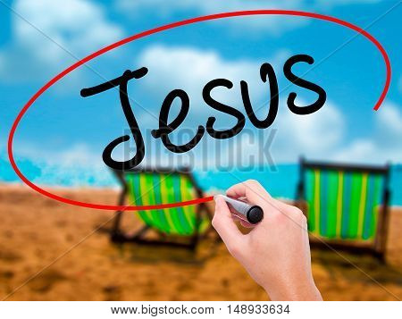 Man Hand Writing Jesus  With Black Marker On Visual Screen