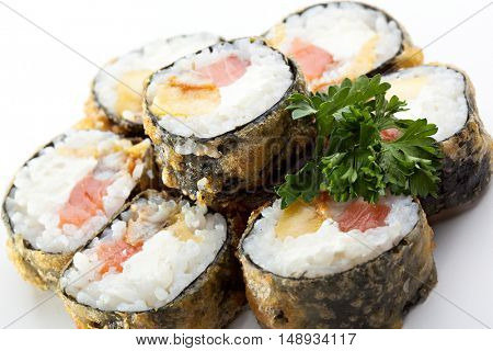 Tempura Maki Sushi - Roll made of Smoked Salmon, Smoked Eel, Pineapple and Cream Cheese inside