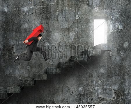 Businessman Carrying Red Arrow Sign Running On Stairs With Door