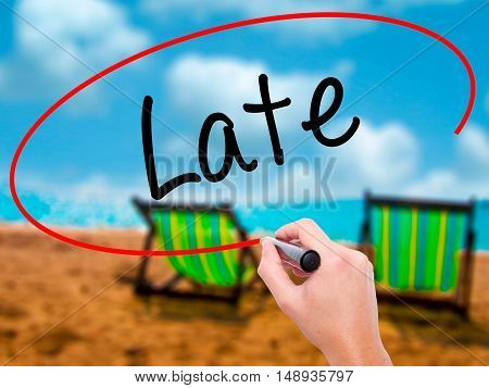 Man Hand Writing Late With Black Marker On Visual Screen