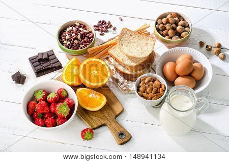 Allergy food concept. Allergic food on white wooden background poster