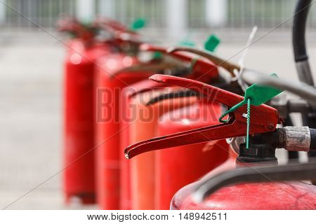 Red fire extinguishers available in fire emergencies.