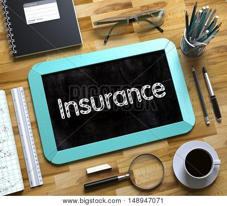 Insurance on Small Chalkboard. Mint Small Chalkboard with Handwritten Business Concept - Insurance - on Office Desk and Other Office Supplies Around. Top View. 3d Rendering.