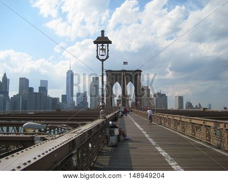 Brooklyn Bridge in New York City view from Brooklyn side with downtown Manhattan skyscrapers landscape, sky and clouds during sunny summer day Travel tourism popular destination background with empty copyspace