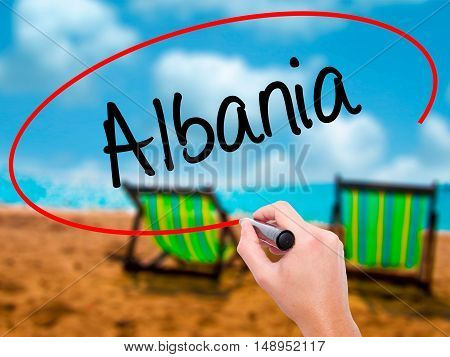 Man Hand Writing Albania  With Black Marker On Visual Screen