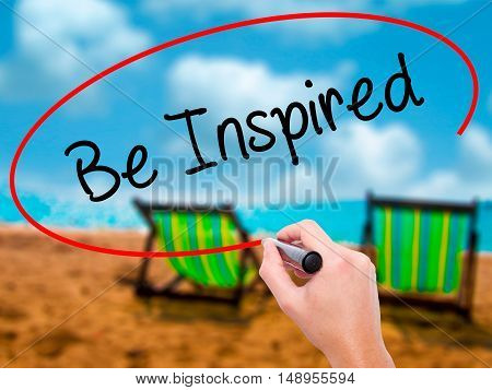 Man Hand Writing Be Inspired With Black Marker On Visual Screen