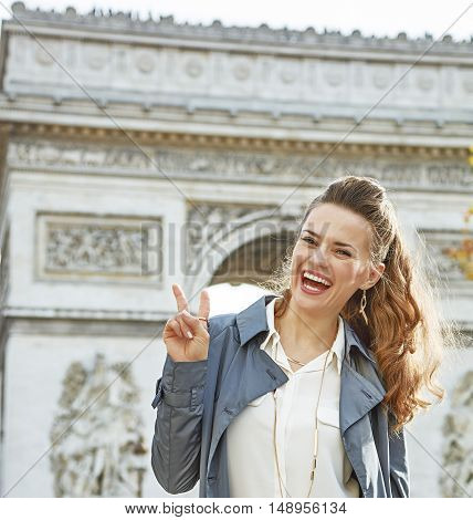 Fashion-monger Near Arc De Triomphe Showing Victory Gesture