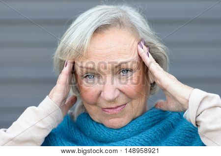 Attractive Stylish Elderly Blue-eyed Woman