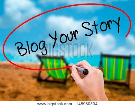 Man Hand Writing Blog Your Story  With Black Marker On Visual Screen