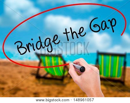 Man Hand Writing Bridge The Gap With Black Marker On Visual Screen