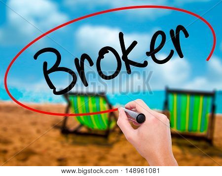 Man Hand Writing Broker With Black Marker On Visual Screen