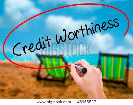Man Hand Writing Credit Worthiness With Black Marker On Visual Screen
