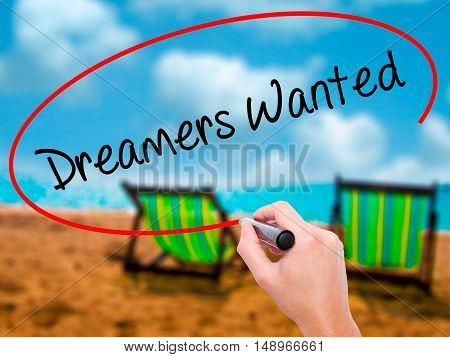 Man Hand Writing Dreamers Wanted  With Black Marker On Visual Screen