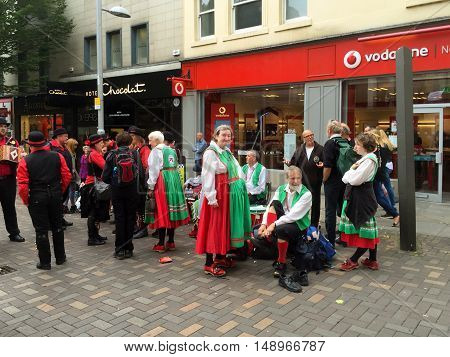 NOTTINGHAM ENGLAND - SEPTEMBER 24: Morris dancers getting ready to perform Albert Street. In Nottingham England. On 24th September 2016.