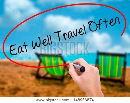 Man Hand Writing Eat Well Travel Often With Black Marker On Visual Screen