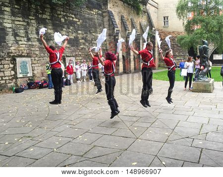 NOTTINGHAM ENGLAND - SEPTEMBER 24: Morris dancers performing near Nottingham Castle. In Nottingham England. On 24th September 2016.
