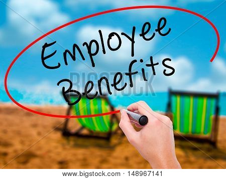 Man Hand Writing Employee Benefits With Black Marker On Visual Screen