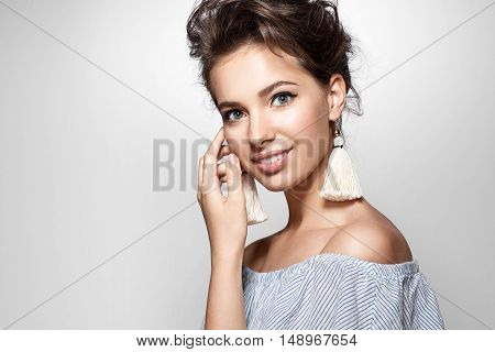 Portrait Of A Girl With A Charming Smile In A Summer Dress And Earrings Tassels