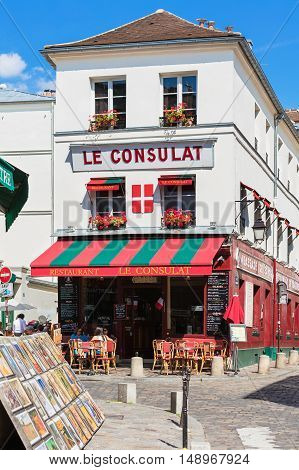 Paris France - July 06 2016: The charming restaurant Le Consulat on Montmartre hill. Montmartre with traditional french cafes and art galleries is one of the most visited landmarks in Paris.