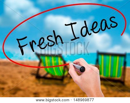 Man Hand Writing Fresh Ideas With Black Marker On Visual Screen