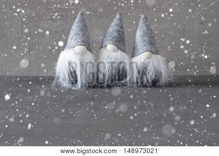 Magic Gnomes As Christmas Decoration. Gray Cement Background With Copy Space And Snowflakes. Modern And Urban Style. Christmas Card For Seasons Greetings