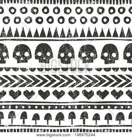 Seamless halloween pattern in tribal style. Monochrome background with grunge texture. EPS 10 vector illustration.
