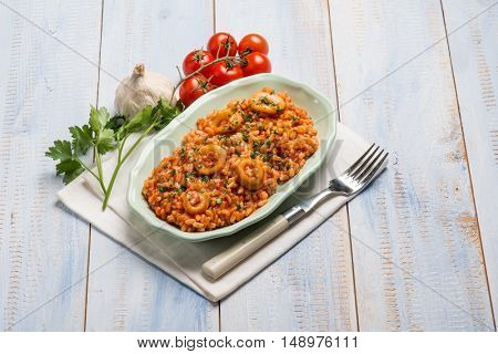 risotto with squid tomato and parsley