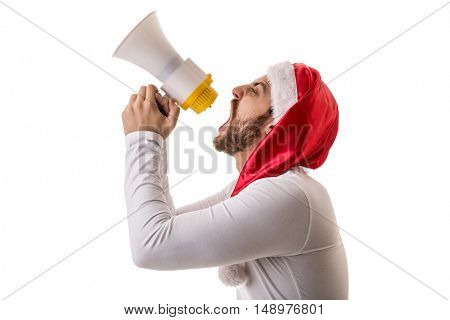 Bearded man in red santa claus christmas hat holding mega phone