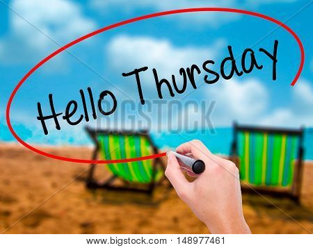 Man Hand Writing Hello Thursday With Black Marker On Visual Screen