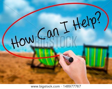 Man Hand Writing How Can I Help? With Black Marker On Visual Screen