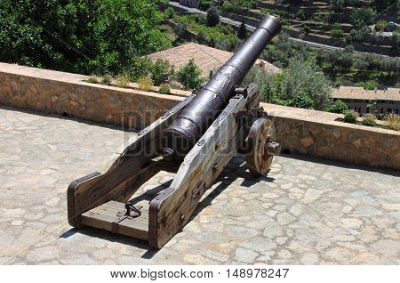 Closeup of an ancient medieval cannon on wheels
