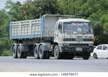 CHIANG MAI, THAILAND - JUNE 11 2015: Dump Truck of Yunsila Company. On road no.1001, 8 km from Chiangmai city.