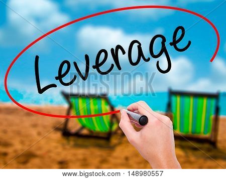 Man Hand Writing Leverage With Black Marker On Visual Screen.