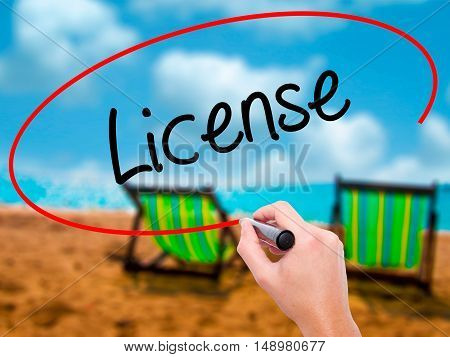 Man Hand Writing License With Black Marker On Visual Screen