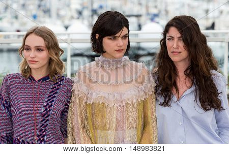 Melanie Thierry, Lily-Rose Depp, Stephanie Di Giusto at the photocall for The Dancer (La Danseuse) at the 69th Festival de Cannes. May 13, 2016  Cannes, France