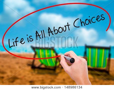 Man Hand Writing Life Is All About Choices With Black Marker On Visual Screen