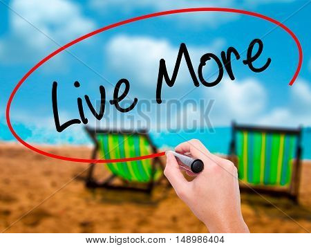 Man Hand Writing Live More With Black Marker On Visual Screen